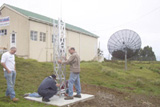 Gilbert Yon holding part of the tower to see if it all lines up with the holes, Robert looks on anxiously!