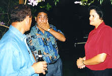 Tony Leo (left) telling a fantastic (?) story to Derek Richards (whoops) with wife Linda.